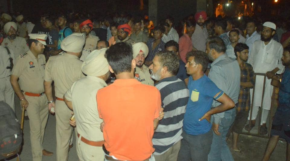 People from the community holding a protest and blocking the road at Basti Jodhewal in Ludhiana on Thursday.