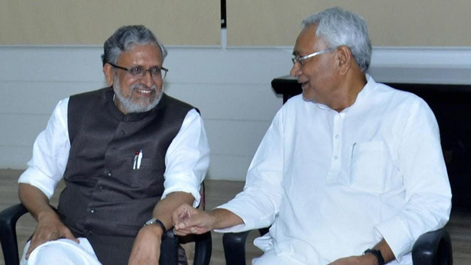 Bihar chief minister Nitish Kumar with senior BJP leader Sushil Kumar Modi at legislators meeting in Patna on Wednesday.