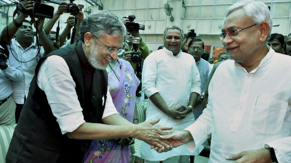 Senior BJP leader Sushil Kumar Modi greets Nitish Kumar after the oath-taking ceremony at Raj Bhawan in Patna on Thursday.