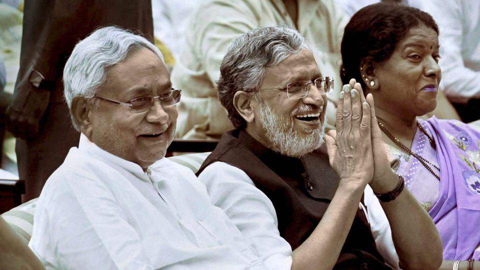 Nitish Kumar with senior BJP leader Sushil Kumar Modi at an oath taking ceremony, at Raj Bhawan in Patna on Thursday.