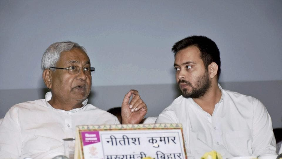 Nitish Kumar with RJD's Tejashwi Yadav at an event in Patna.
