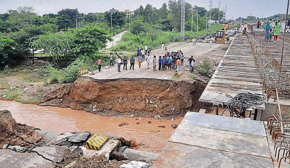 At Manakya, a bridge was coming up. A road constructed six months back was being used. The storm water pipes used to go under it. But on Thursday, the flow of water was so high, that it gave in.