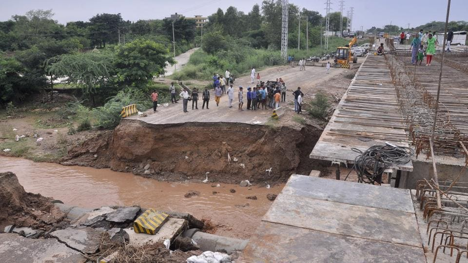 A part of national highway 73  at Mankiya village in Panchkula was washed away after heavy rains lashed in the region on Thursday. (Sant Arora/HT Photo)