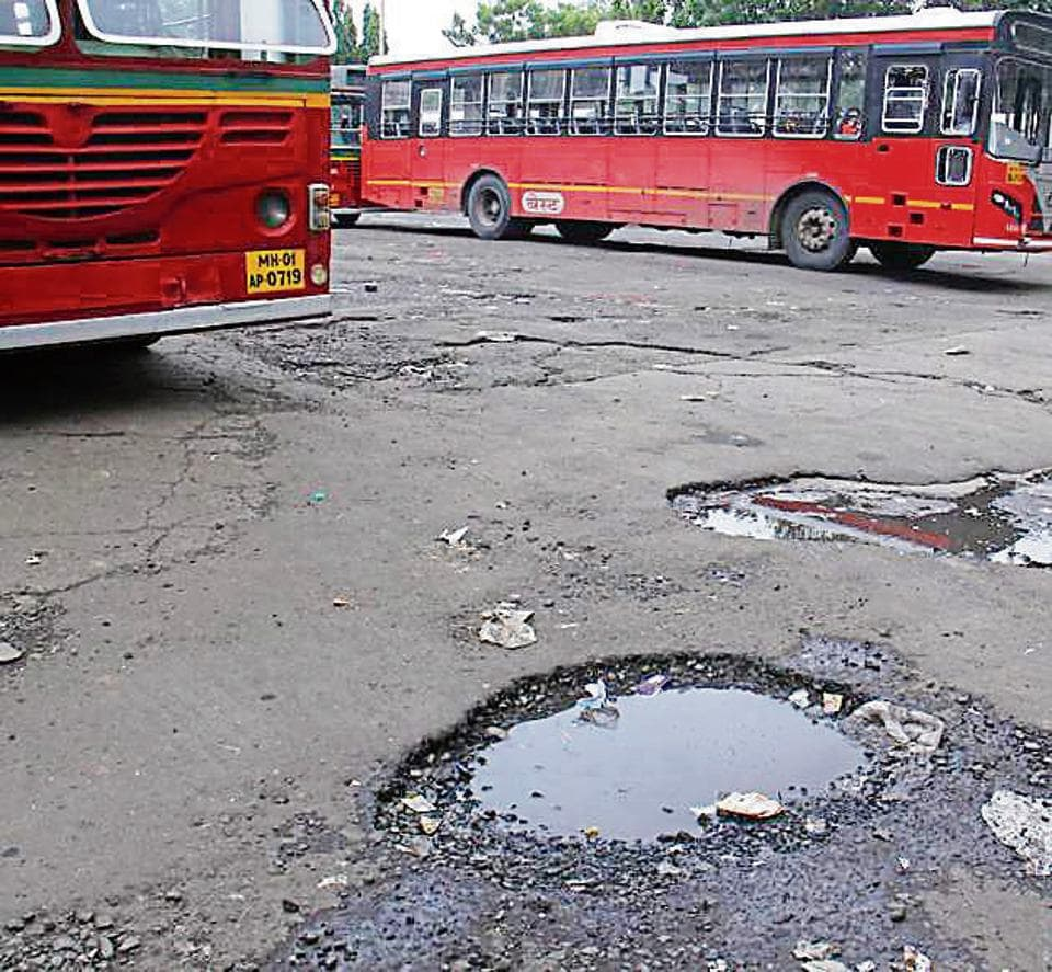 Potholes outside Bandra bus depot on Wednesday.
