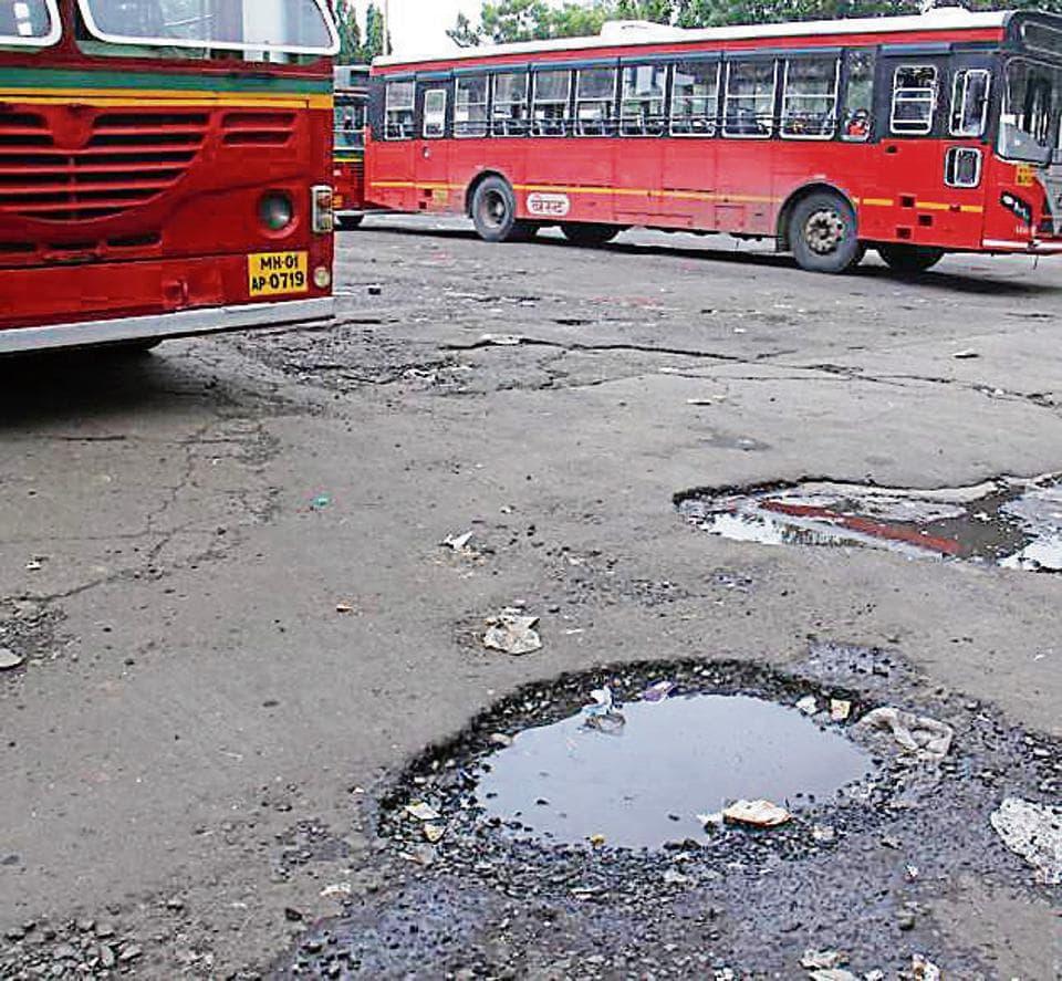 Potholes outside Bandra bus depot on Wednesday.