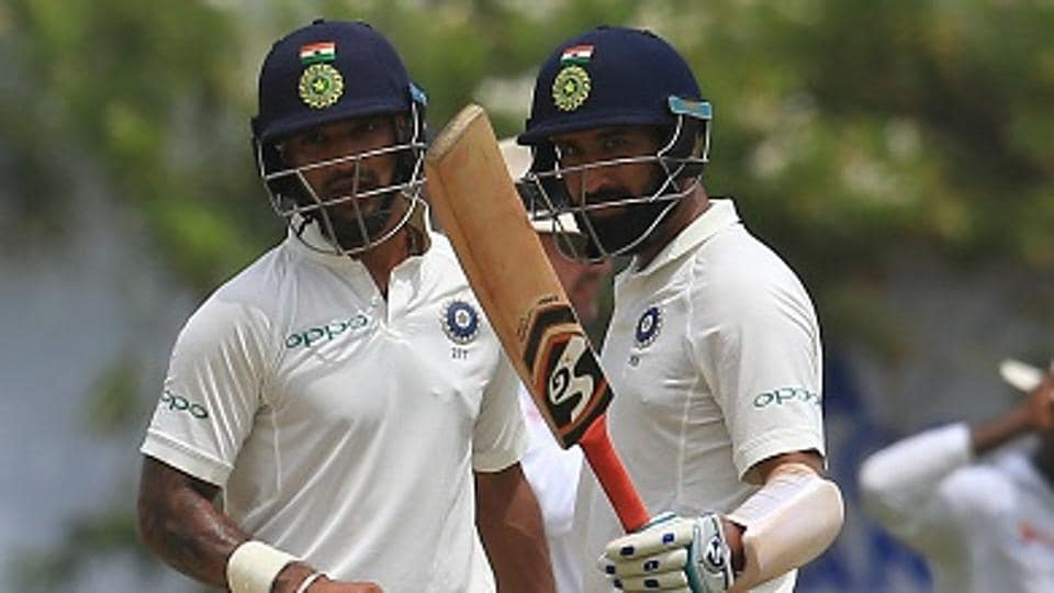 Cheteshwar Pujara (R) and Shikhar Dhawan during Day 1 of the first Test between Sri Lanka national cricket team and Indian cricket team at the Galle International cricket stadium on Wednesday.