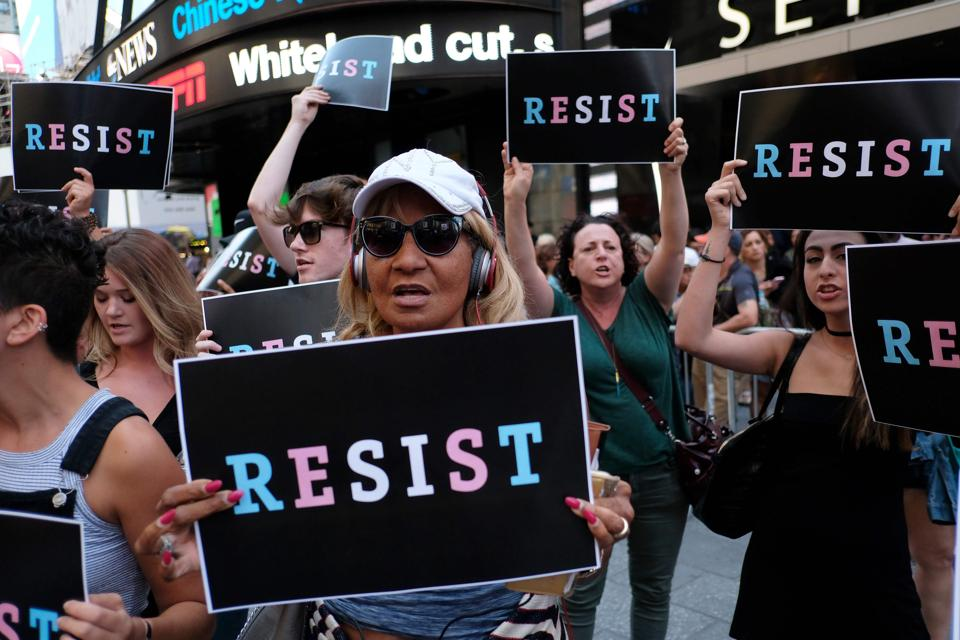 Protesters shout slogans against Donald Trump during a demonstration in front of the US Army career centre in Times Square, New York, on July 26, 2017.