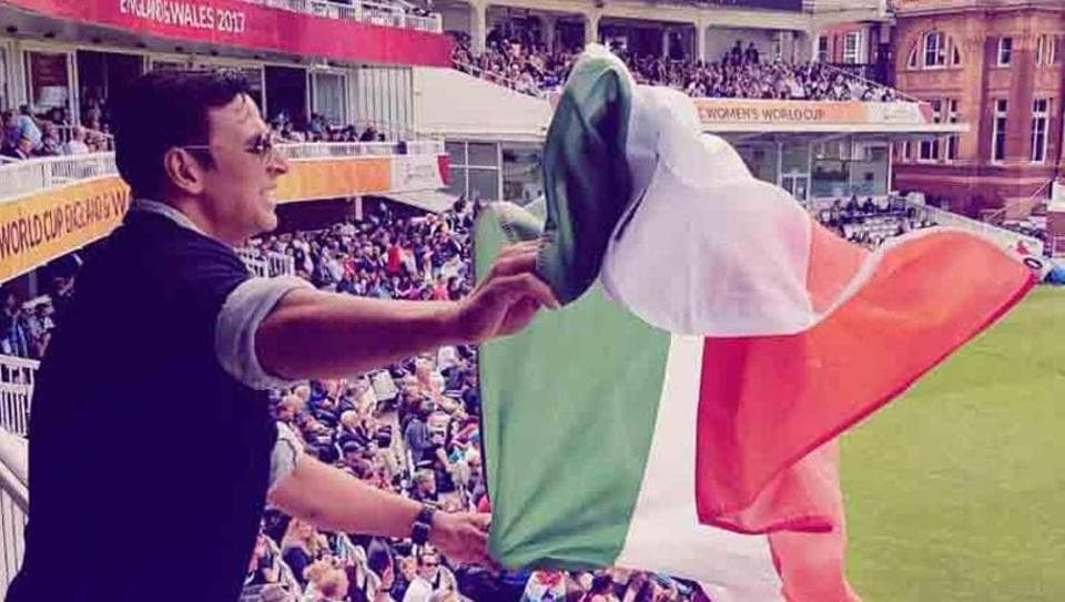 Akshay Kumar in the controversial image, where he is seen holding the India flag upside down, cheering for the Indian women's cricket team during their ICCwomen's World Cup final against England cricket team at Lord's in London.