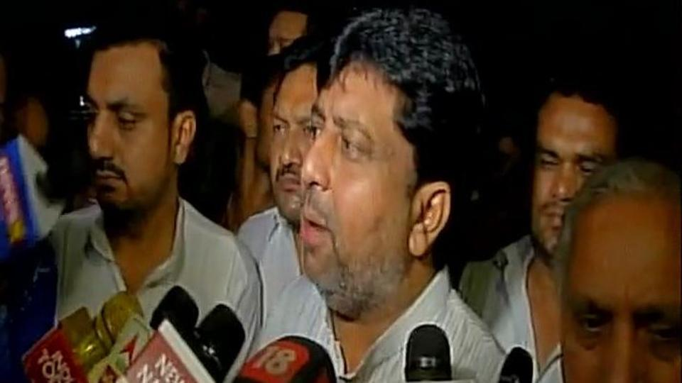 Gujarat Congress MLA Shailesh Parmar addresses reporters outside the airport inAhmedabad.