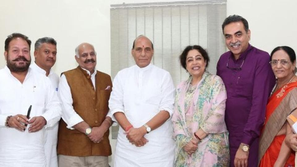 UT administrator VP Singh Badnore, MP Kirron Kher, other officials with Union home minister Rajnath Singh in New Delhi on Thursday.