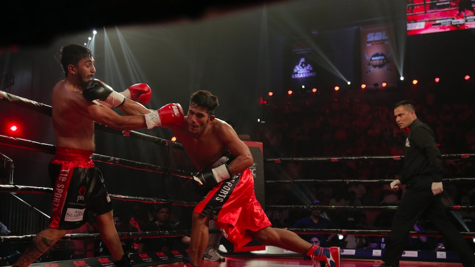 Lucknow's Amitesh Chaubey (right) in action during his fight in the Super Boxing League (SBL).