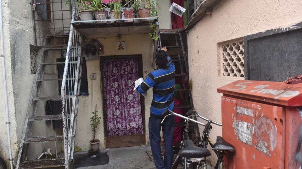 Akshay Mare distributes newspapers in the slum area at Dandekar bridge in Pune.