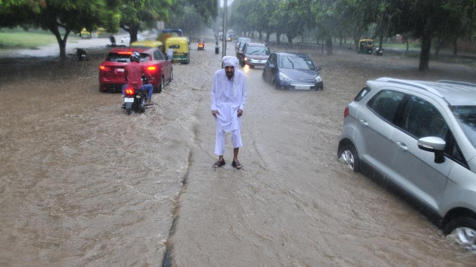 A city loses way: A waterlogged stretch of the road dividing sector 17 and 18 on Thursday. HT ran a five-part series before the monsoon arrived, but things have not changed.