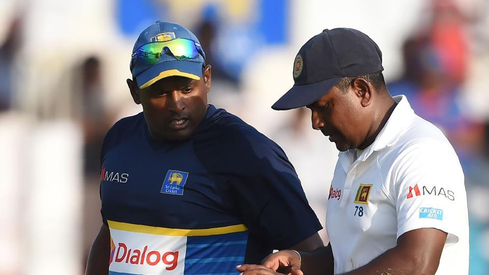 Rangana Herath, Sri Lankan captain, grimaces in pain after being injured during the third day of the first Test against India.