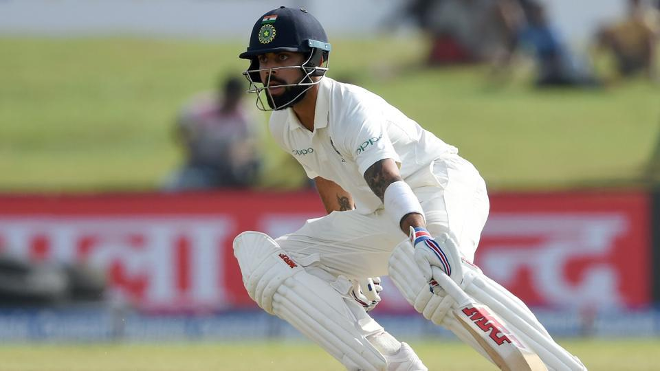 Virat Kohli runs between the wickets during the third day of the first Test between Sri Lanka and India at Galle International Cricket Stadium in Galle.