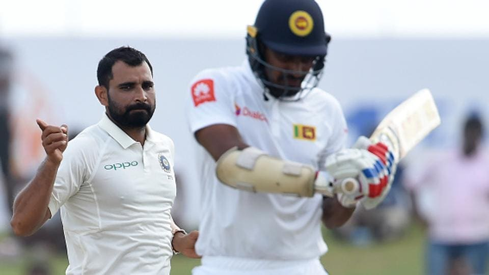 Indian cricket team's Mohammed Shami (L) celebrates after dismissing Sri Lanka national cricket team batsman Danushka Gunathilaka (R) during the second day of the first Test at Galle International Cricket Stadium on Thursday.