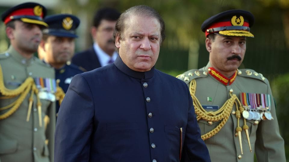 Former Pakistan Prime Minister Nawaz Sharif  looks on after inspecting a guard of honour during a welcoming ceremony at the Prime Minister's House in Islamabad on June 5, 2013.
