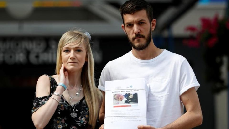 Connie Yates and Chris Gard, pose for the media with a petition, outside Great Ormond Street Hospital, in central London, Britain July 9, 2017.