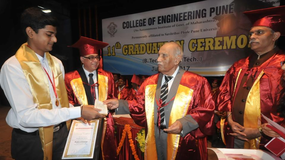 Anuj Nahar receives a gold medal from the vice chancellor of Savitribai Phule Pune University, NR Karmalkar, during the graduation ceremony of the 11th batch of engineers at  College of Engineering, Pune on Thursday.