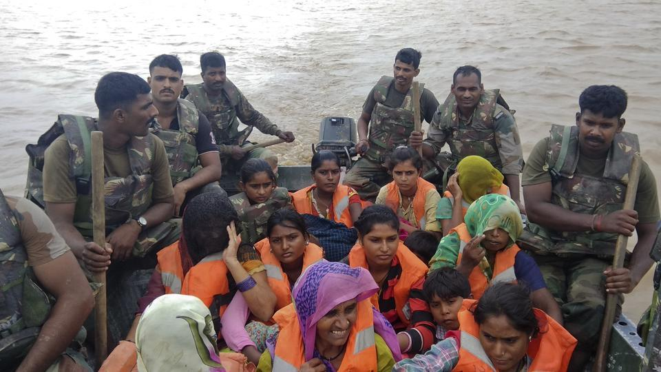 India army soldiers rescue flood affected villagers near Shihori in Banaskantha district. (Ajit Solanki / AP)