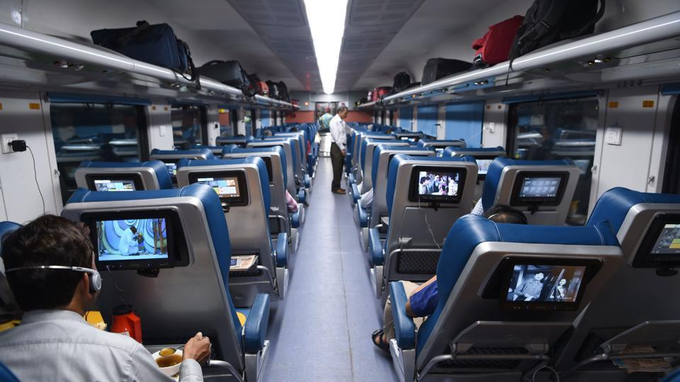 Passengers travel on the Tejas Express luxury train during its first journey between Mumbai and Goa. The train service features Wifi and in-rail entertainment.