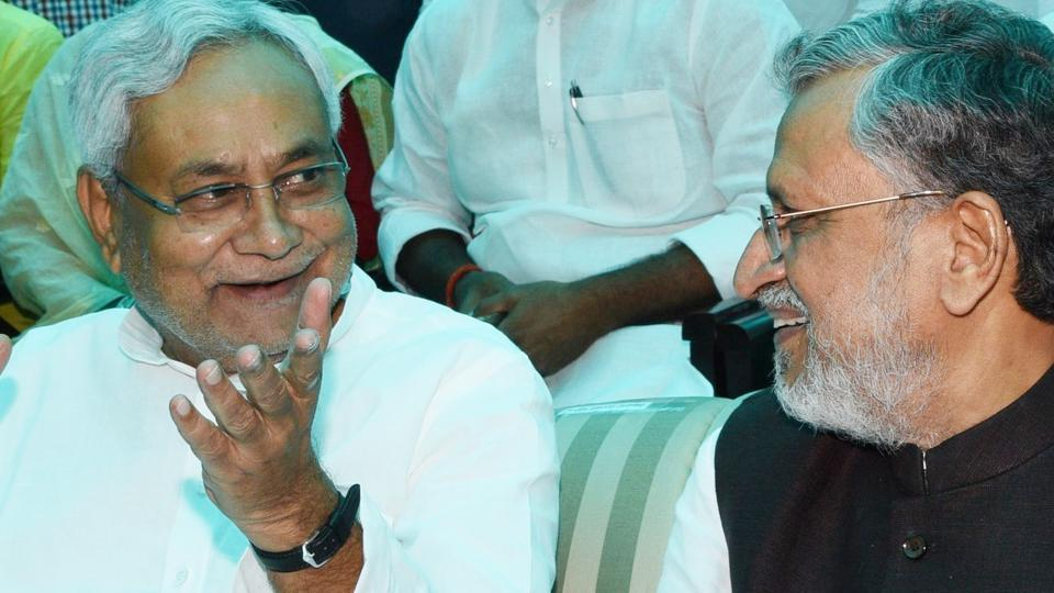 Bihar chief minister Nitish Kumar (left) with BJP leader Shushil Modi at the Raj Bhavan in Patna on Thursday.
