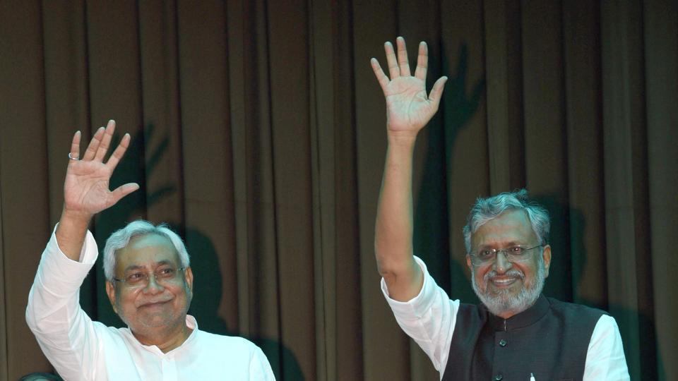 Bihar chief minister Nitish Kumar and BJP leader Shushil Modi at Raj Bhavan in Patna on Thursday.