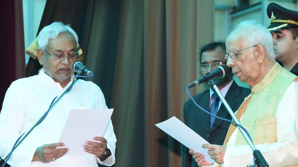 Bihar governor Keshari Nath Tripathi administers oath to JD(U) president Nitish Kumar as chief minister at Raj Bhawan in Patna on Thursday.