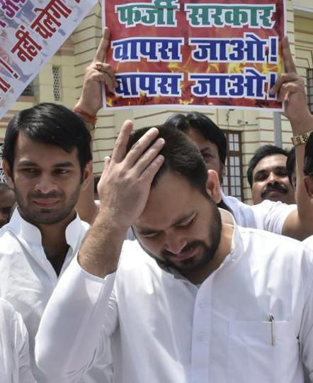 RJD leaders Tejashwi Yadav and Tej Pratap Yadav after the trust vote in Bihar assembly, in Patna on Friday.