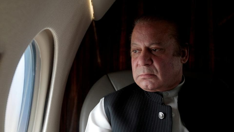 Pakistani Prime Minister Nawaz Sharif looks out the window of his plane.
