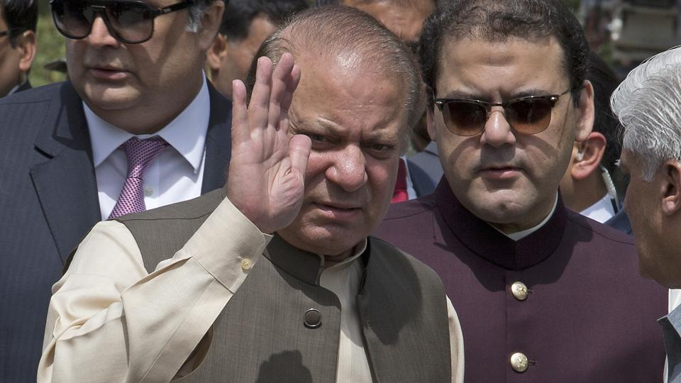 Pakistani Prime Minister Nawaz Sharif with his son Hussain Nawaz, right, outside the premises of the Joint Investigation Team, in Islamabad, Pakistan on June 15, 2017.
