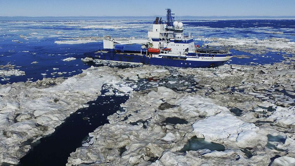 The Finnish icebreaker MSV Nordica sails through ice floating on the Beaufort Sea off the coast of Alaska while traversing the Arctic's Northwest Passage, where global warming is melting sea ice and glaciers at an unprecedented rate, opening up once impenetrable Arctic routes to oil exploration and climate change observers.  (David Keyton / AP)