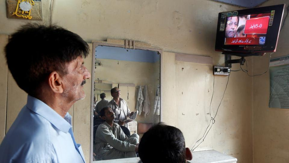 Men look at a television screen displaying coverage of Pakistan's Supreme Court's decision against Pakistan's Prime Minister Nawaz Sharif, at a barber shop in Karachi. Pakistan faces uncertainty over the now vacant position of its Prime Minister. Names tipped to replace Sharif so far include his brother Shehbaz Sharif, Punjab province chief minister, as well as Shahid Khaqan Abbasi, another Pakistan Muslim League (Nawaz) (PML-N) lawmaker and current Speaker Ayaz Sadiq as well as defence minister Khawaja Asif according to Pakistan media reports. (Akhtar Soomro / REUTERS)