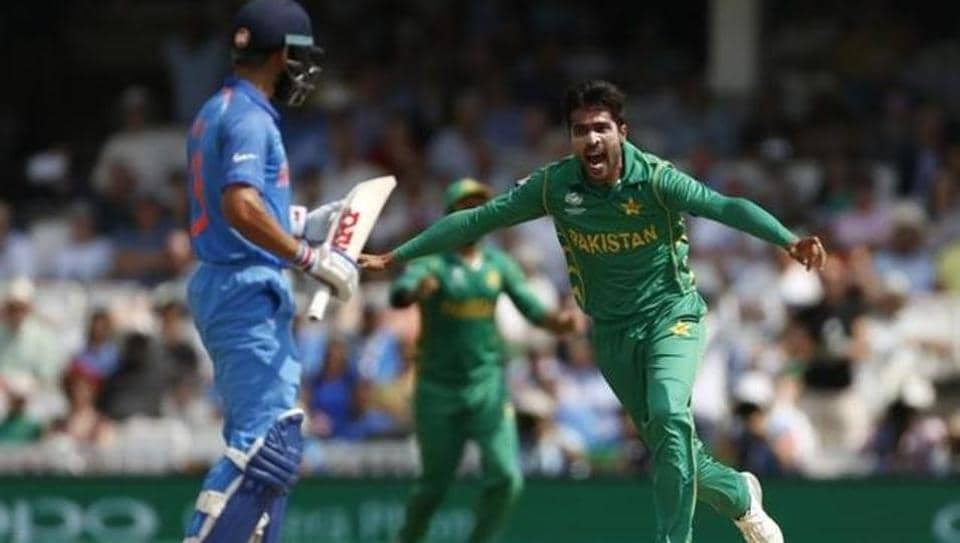 Mohammad Amir celebrates taking the wicket of India's Virat Kohli during the ICC Champions Trophy final at The Oval on June 18, 2017. The Pakistan speedster rubbished reports on his retirement