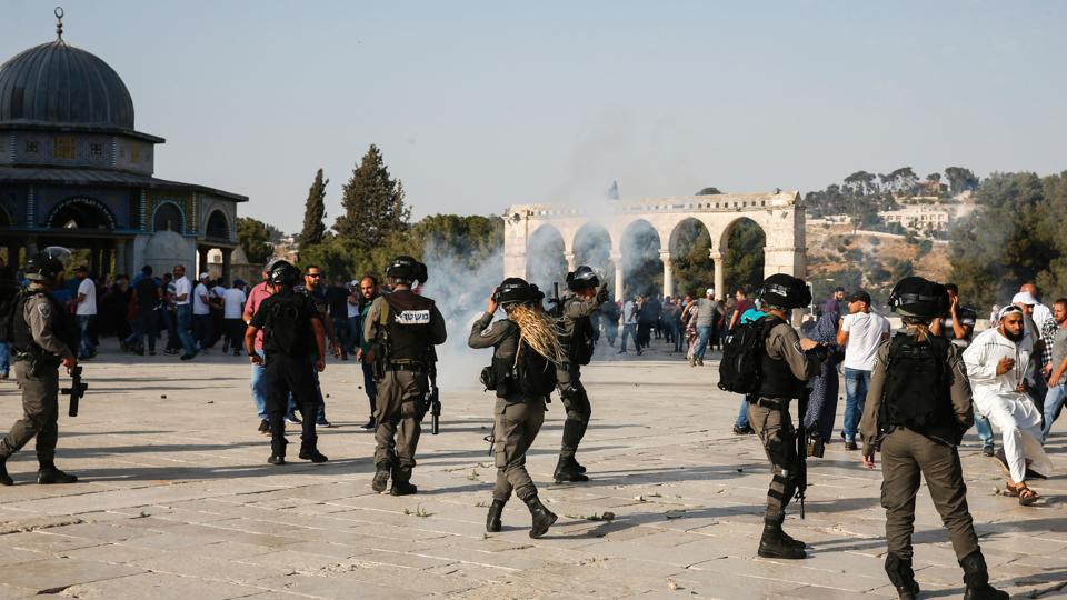 Tear-gas fumes are seen in the Haram al-Sharif compound, as Israeli security forces disperse Palestinians who entered the complex, in the old city of Jerusalem on July 27.