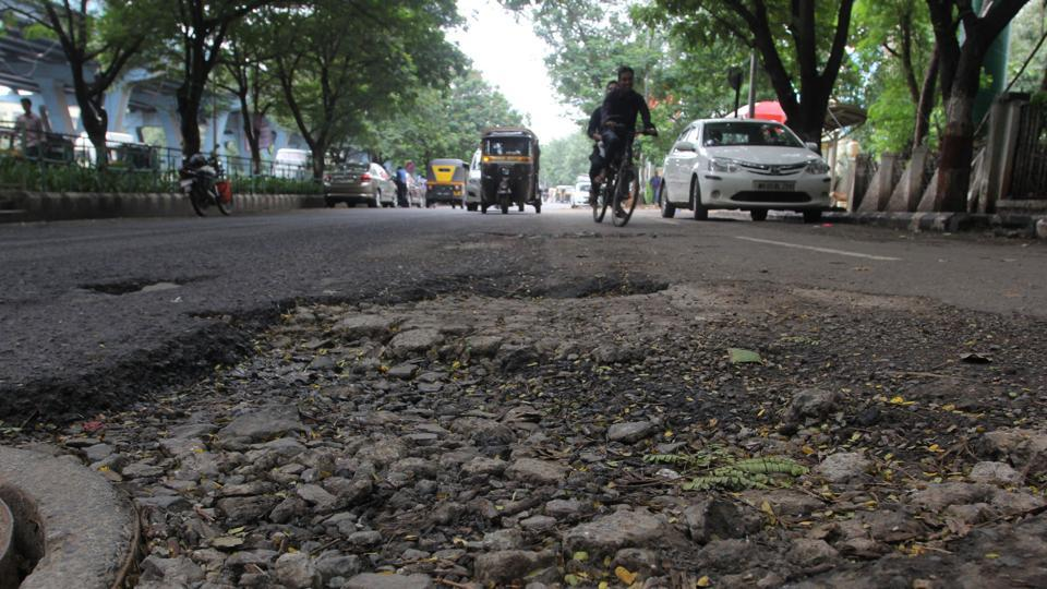Potholes at Mangal Pandey Service Road near Cadbury Junction in Thane on Friday