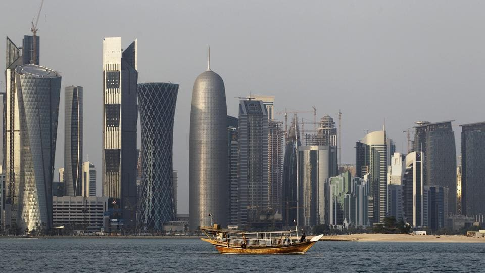 A traditional dhow floats in the Corniche Bay of Doha, Qatar, with tall buildings of the financial district in the background. In the region's worst diplomatic crisis in years, Riyadh and allies have been boycotting Doha since June 5.