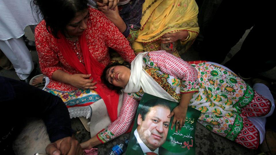 A supporter of Pakistan's Prime Minister Nawaz Sharif passes out after the Supreme Court's decision to disqualify Sharif in Lahore, Pakistan. The country is less than a year away from the 2018 general elections. The existing ruling party is expected to be provided a chance to select an interim Prime Minister for the remainder of Sharif's term by the Speaker of the National Assembly. (Mohsin Raza / REUTERS)