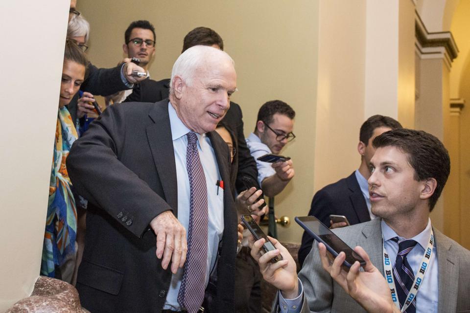 US senator John McCain leaves the Senate Chamber after voting against a stripped-down version of Obamacare on July 28, 2017.
