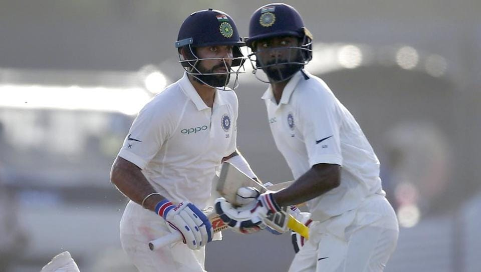 India captain Virat Kohli(L)and Abhinav Mukund extented their lead against SriLanka on the third day of the first Test in Galle. (AP)