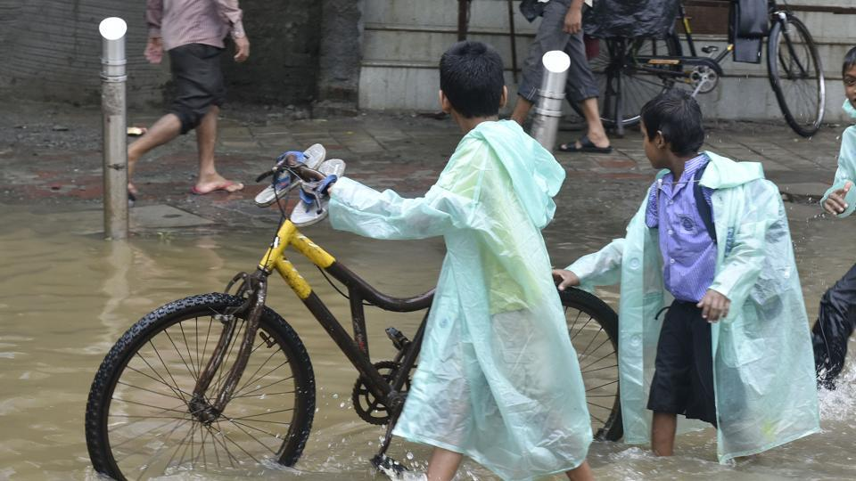 People are a high risk of catching the disease when they wade through flooded streets.