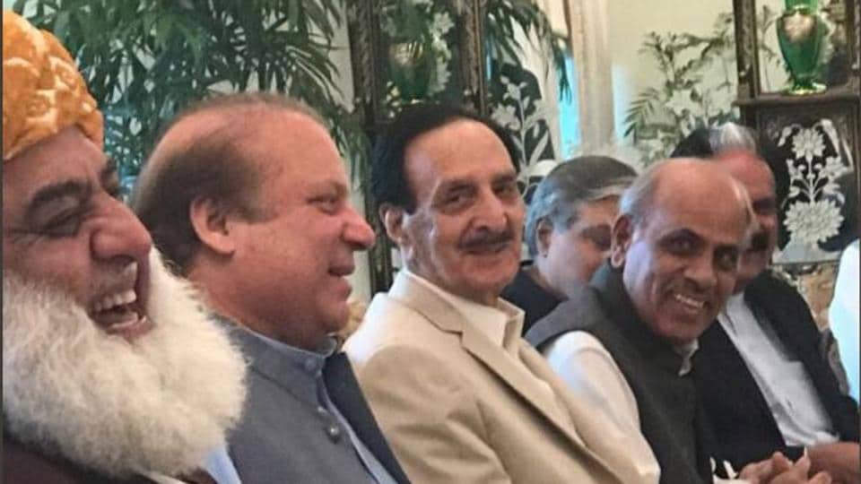 Former Pakistan prime minister Nawaz Sharif (second from left) with leaders of his PML-N party and its allies during a meeting in Islamabad on July 28, 2017.