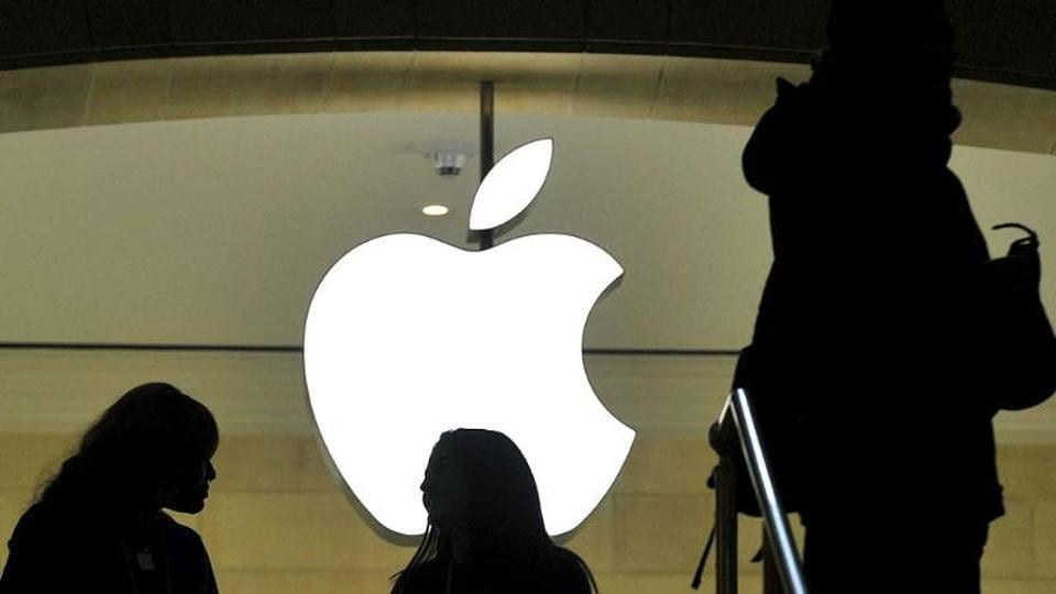 People walk past the Apple logo at the Apple Store at Grand Central Terminal in New York.