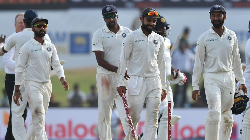 Indian cricket team captain Virat Kohli (C) and teammates leave the pitch after beating Sri Lanka by 304 runs in the Galle Test on Saturday.