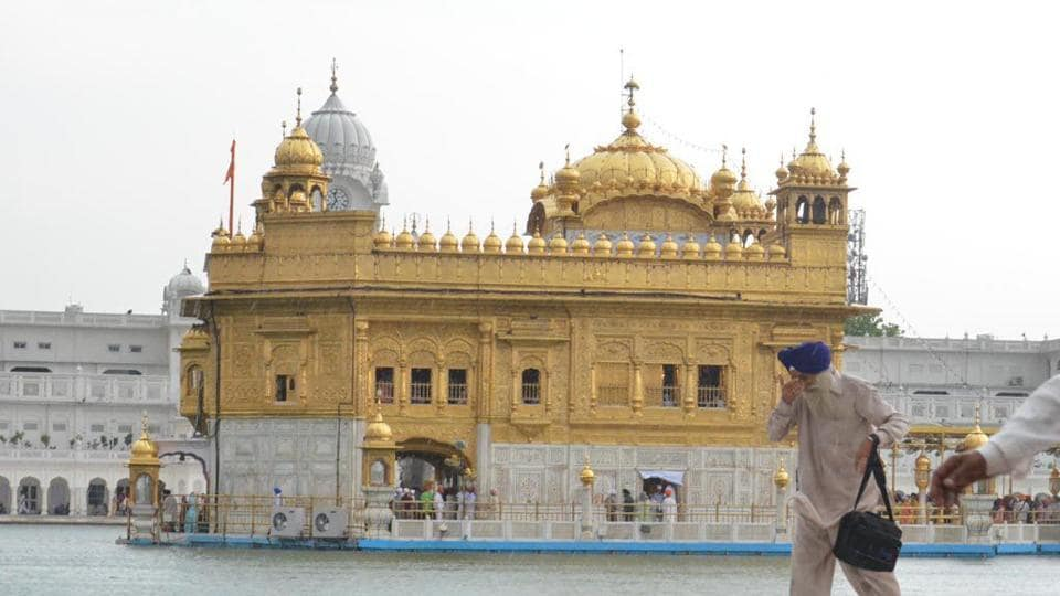 A devotee pays obeisance at Golden Temple in Amritsar.