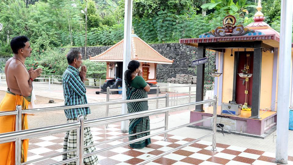 People pray at the Cheruvally Sree Bhagavathy Temple in Kottayam district.