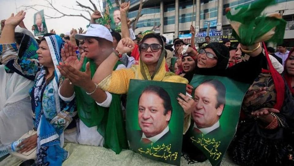 Supporters of Pakistan's former prime minister Nawaz Sharif in Lahore react after the Supreme Court's decision to disqualify Sharif.