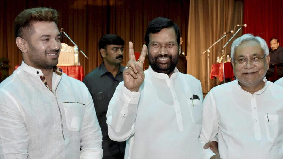 Bihar chief minister Nitish Kumar (R) with Union minister Ram Vilas Paswan (C) and MP Chirag Paswan during swearing-in ceremony of ministers in Bihar cabinet at Raj Bhawan in Patna on Saturday.