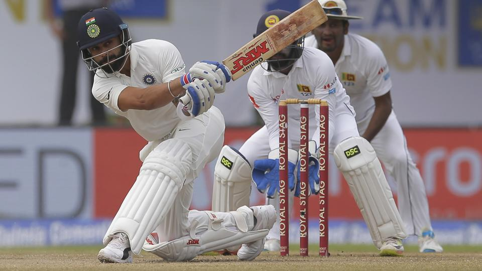 Indian cricket captain Virat Kohli plays a shot during the fourth day's play of the first test cricket match between India and Sri Lanka in Galle.