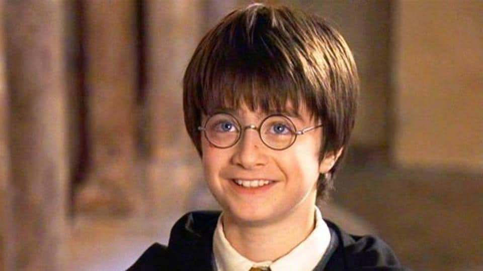 Harry tries the Invisibility Cloak for the first time in Harry Potter and the Philosopher's Stone.
